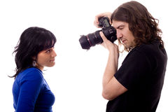 Photographer and model. Photographer and beautiful woman white isolate Royalty Free Stock Photos