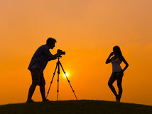 Photographer and Model in Back Lit Royalty Free Stock Photos
