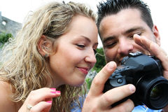 Photographer and model checking photos Stock Images