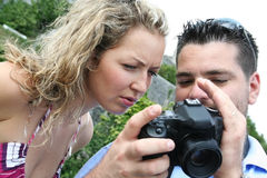 Photographer and model checking photos Royalty Free Stock Photography