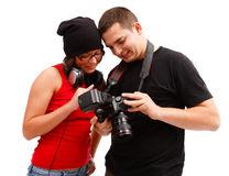 Photographer and model looking at photos Stock Photo