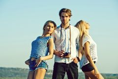Photographer with models. girls and man or photographer with camera. Photographer with models. girls and men or photographer with camera posing on idyllic royalty free stock photography
