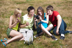 Photographer with models in park Stock Photography