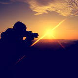 Photographer in the morning Stock Images