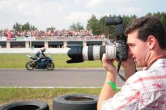 Photographer on motorcycle race. Day stock photography