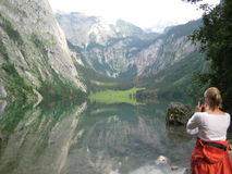 Photographer in the Mountains. This picture shows a female photographer taking at the Konigssee in Germany Stock Images