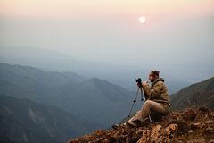 Photographer in mountains Royalty Free Stock Photography