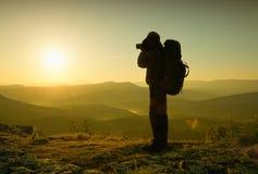 Photographer in mountains Stock Photos