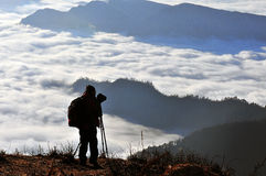 Photographer in mountains Royalty Free Stock Photo