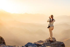Photographer in the mountains of Oman Royalty Free Stock Images