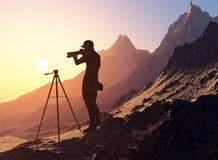 Photographer in the mountains. Stock Photo