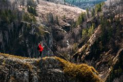 Photographer in the mountains. Traveler in the mountains. Photo tours. Camping trip. Tours in the mountains. Professional royalty free stock photo