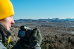 Photographer naturalist at work. In winter on top of the mountain Stock Photography