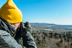 Photographer naturalist at work. In winter on top of the mountain Stock Photo