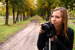 Photographer on the nature. Woman the photographer on the nature Stock Image
