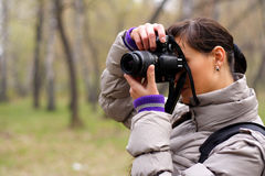 Photographer on the nature. Woman the photographer on the nature Royalty Free Stock Images