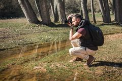 Photographer in nature takes pictures of the landscapes. stock images