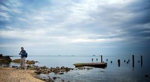 Photographer near the sea. Photographer near the blue sea Royalty Free Stock Photography