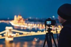Photographer in the night city Stock Photos
