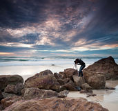 Photographer by the ocean Stock Photos