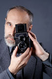 Photographer with old camera Royalty Free Stock Photos