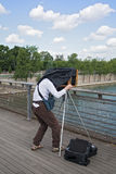 Photographer with old plate camera on the seine bridge Passerelle Solferino in Paris Royalty Free Stock Photography
