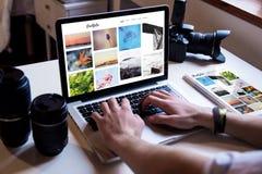 Photographer online portfolio. Photographer managing his online portfolio royalty free stock photo