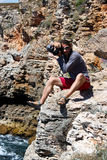 Photographer outdoor. Young man taking photos in nature Royalty Free Stock Photo