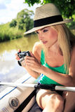 Photographer. Outdoor portrait of a female photographer in the boat Stock Photography