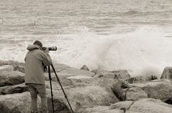Photographer over the cliff Royalty Free Stock Images