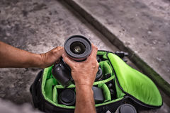 Photographer pack his camera and lenses to bagpack. Bag applianc Stock Photography