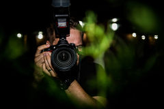 Photographer paparazzi. Photographer taking pictures with professional DSLR photo camera Royalty Free Stock Photography