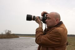 Photographer at park against  river Stock Photo