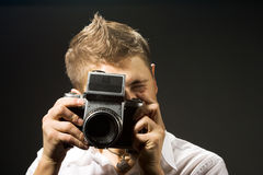 Photographer with photo camera Stock Photos