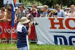 Photographer or photo journalist captures images at the 2013 Midmar Mile swimming event, South Africa. MIDMAR DAM - 10 FEBRUARY 2013: An unidentified news Stock Image