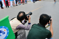 Photographer. S working condition.Half international marathon in fushui county in yunnan province in China, time: on September 25, 2013 Stock Images