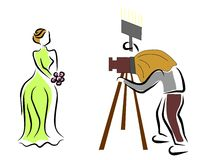 Photographer. Photographing a beauty woman Royalty Free Stock Images