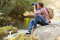 Photographer photographing mountain Royalty Free Stock Images