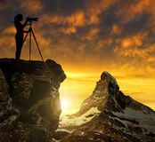 Photographer photographing the sunset over the Matterhorn. Swiss Alps Royalty Free Stock Image