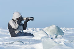 The photographer is photographing with telephoto lens Royalty Free Stock Photography