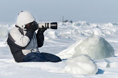 The photographer is photographing with telephoto lens Stock Photography