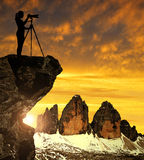Photographer photographing Tre Cime di Lavaredo. Photographer photographing the sunset over the Tre Cime di Lavaredo ,Dolomite Alps, Italy Royalty Free Stock Image