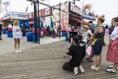 Free Photographer Photographs A Fashion Model Girl In Coney Island Beach, New York City, USA Stock Photo - 145030510