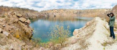 Photographer photographs the lake Stock Photography