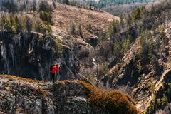 Photographer in the mountains. Traveler in the mountains. Photo tours royalty free stock photo