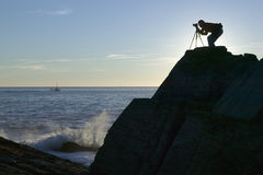 Photographer photographs Portland Head Lighthouse, Cape Elizabeth, Maine Royalty Free Stock Photo