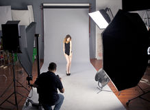 The photographer photographs the professional model Stock Image