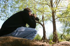 The photographer on photohunting. Stock Photos