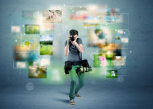 Photographer with pictures from the past Royalty Free Stock Images
