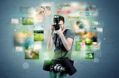 Photographer with pictures from the past Royalty Free Stock Photo